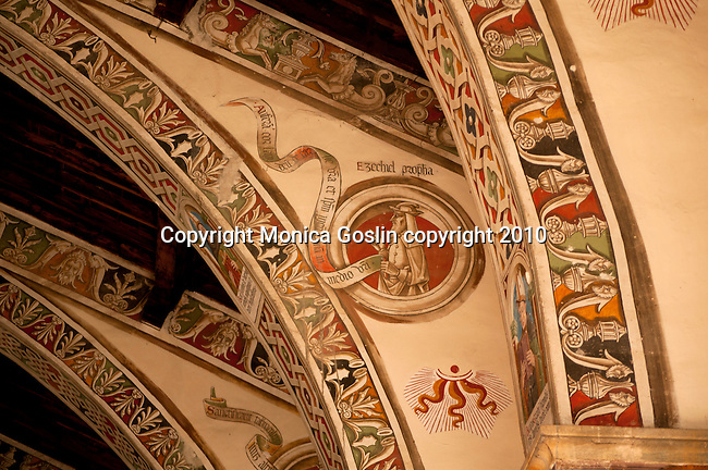 A detail of the 15th century frescos painted on the beams and arches in the Santa Maria delle Grazie Church in Gravedona, a town on Lake Como Italy