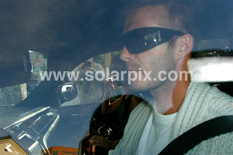 **ALL ROUND PICTURES FROM SOLARPIX.COM**.**WORLDWIDE SYNDICATION RIGHTS EXCEPT FOR USA, AUSTRALIA & GERMANY**.David and Victoria Beckham were spotted leaving a sushi restaurant in West Hollywood, CA on Sunday afternoon. The couple were wearing giant wrap-around sun glasses and both were looking extremely miserable, possibly due to the imminent departure of David for Italy where he is on going on loan to AC Milan for three months. The move has not been welcomed by Victoria..JOB REF:     7902   LAS       DATE: 17.11.08.**MUST CREDIT SOLARPIX.COM OR DOUBLE FEE WILL BE CHARGED* *UNDER NO CIRCUMSTANCES IS THIS IMAGE TO BE REPRODUCED FOR ANY ONLINE EDITION WITHOUT PRIOR PERMISSION*