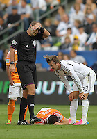 CARSON, CA - DECEMBER 01, 2012:   David Beckham (23) of the Los Angeles Galaxy leans over the injured Brad Davis (11) of the Houston Dynamo during the 2012 MLS Cup at the Home Depot Center, in Carson, California on December 01, 2012. The Galaxy won 3-1.
