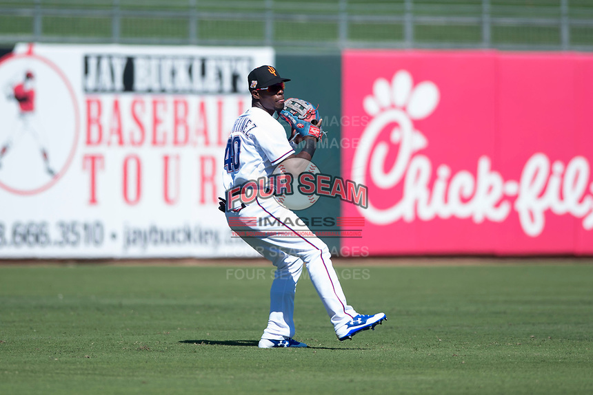 Surprise Saguaros outfielder Julio Pablo Martinez (40), of the Texas Rangers organization, prepares to make a throw to home plate during an Arizona Fall League game against the Salt River Rafters on October 9, 2018 at Surprise Stadium in Surprise, Arizona. Salt River defeated Surprise 10-8. (Zachary Lucy/Four Seam Images)
