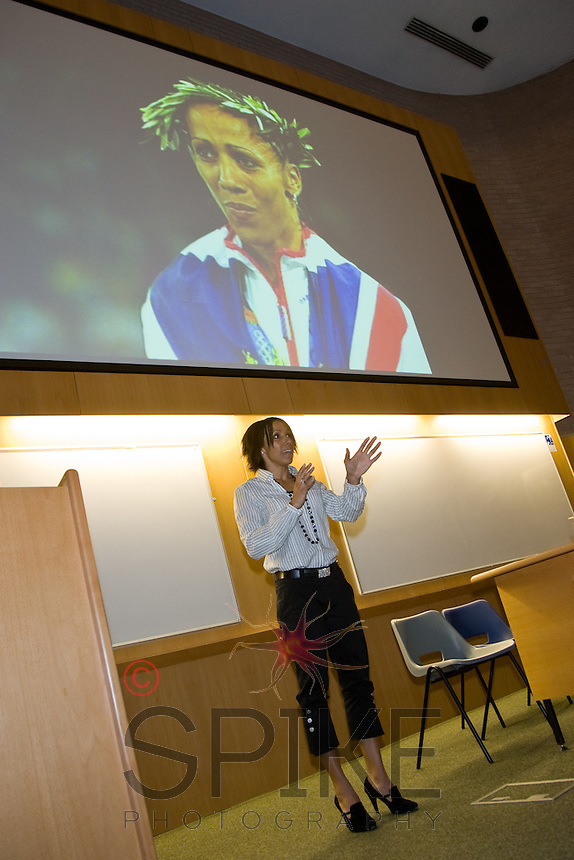 Dame Kelly Holmes speaks at a seminar in Nottingham. She's pictured at the Olympics, draped in a Union Jack.