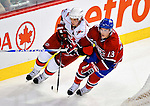 31 March 2010: Montreal Canadiens' left wing forward Mike Cammalleri (13) skates alongside Carolina Hurricanes' center Eric Staal (12) at the Bell Centre in Montreal, Quebec, Canada. The Hurricanes defeated the Canadiens 2-1. Mandatory Credit: Ed Wolfstein Photo