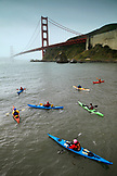 USA, California, San Francisco, individuals endure the cold to kayak under the Golden Gate Bridge