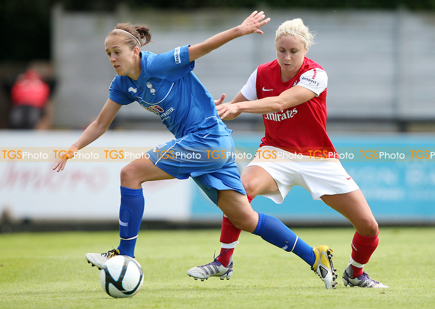 Steph Houghton of Arsenal and Jo Potter of Birmingham - Arsenal Ladies versus Birmingham City Ladies, Women's Super League at Boreham Wood FC - 24/06/12 - MANDATORY CREDIT: Rob Newell/TGSPHOTO - Self billing applies where appropriate - 0845 094 6026 - contact@tgsphoto.co.uk - NO UNPAID USE..