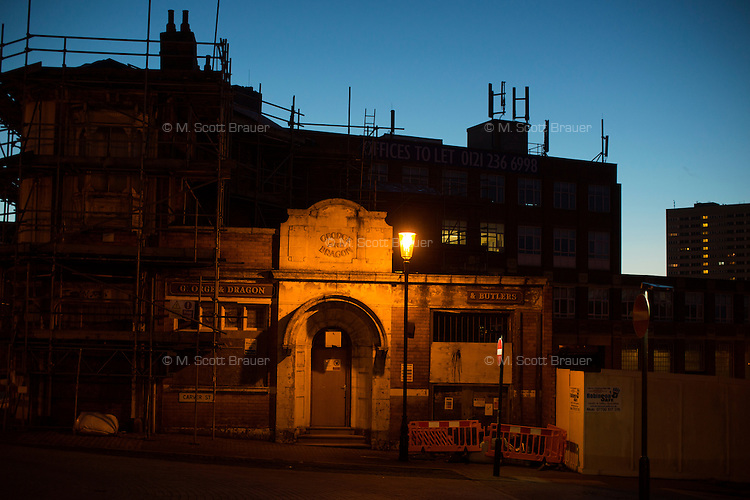 Buildings lit by streetlights stand in the Jewellery Quarter in Birmingham, England.