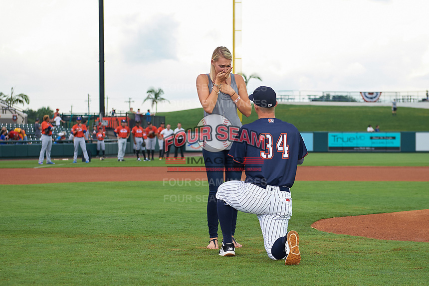 Tampa Yankees pitcher Andrew Schwaab proposes to his girlfriend Lauren Stoeckle during pre-game first pitch ceremonies before the Florida State League All-Star Game on June 17, 2017 at Joker Marchant Stadium in Lakeland, Florida.  FSL North All-Stars  defeated the FSL South All-Stars  5-2.  (Mike Janes/Four Seam Images)