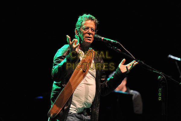 Lou Reed.Performing live at the Hammersmith Apollo, London, England..July 4th, 2011.stage concert live gig performance music half length black leather jacket white top singing glasses hands.CAP/MAR.© Martin Harris/Capital Pictures.