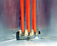 NICHROME HEATING ELEMENT OF ELECTRIC HEATER<br /> Glowing Red<br /> Resistance to electrical current causes the element to glow