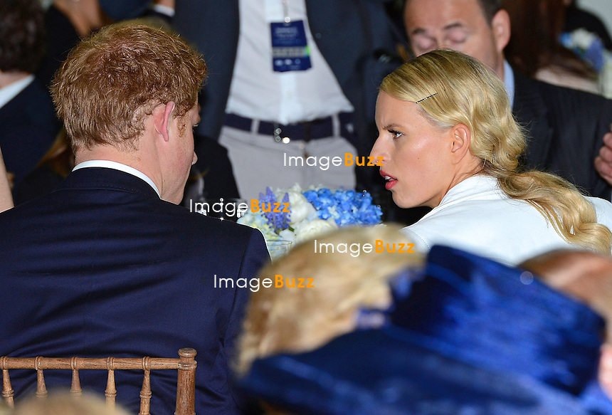 PRINCE HARRY AND KAROLINA KURKOVA.chat at the lunch prior to the Sentabale Charity Polo Match at the Greenwich Polo Club, Conneticut_15/05/2013.Prince Harry is on a week long USA visit the includes Washington, Denver, Colorado Springs, New Jersey, New York and Conneticut.