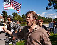 Dan waves a flag while Dew-b carries his flute during a chant at the Occupy Orange County, Irvine march on November 5.