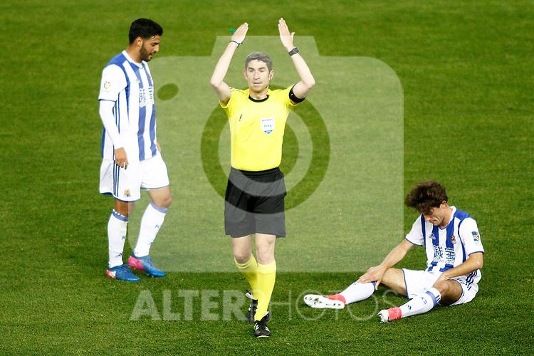 Real Sociedad's Alvaro Odriozola injured in presence of the spanish referee Alberto Undiano Mallenco (c) and Carlos Vela (l) during La Liga match. April 4,2017. (ALTERPHOTOS/Acero)