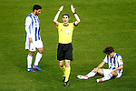 Real Sociedad's Alvaro Odriozola injured in presence of the spanish referee Alberto Undiano Mallenco (c) and Carlos Vela (l) during La Liga match. April 4,2017. (ALTERPHOTOS/Acero)