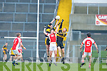 Daniel O'Shea Currow catches the ball over team mate Seamus Flynn and Rathmore's Donal O'Sullivan in the O'Donoghue cup semi final in Fitzgerald Stadium on Sunday