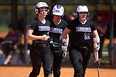 Nazareth College Golden Flyers Kristen Simmons (2), Sarah Papponetti (4), and Jessica Mount (12) during a game against the Edgewood Eagles on March 12, 2017 at North Collier Park in Fort Myers, Florida.  (Mike Janes/Four Seam Images)