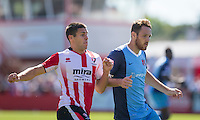 Dan Holman of Cheltenham and Tom Parkes of Leyton Orient during the Sky Bet League 2 match between Cheltenham Town and Leyton Orient at the LCI Rail Stadium, Cheltenham, England on 6 August 2016. Photo by Mark  Hawkins / PRiME Media Images.