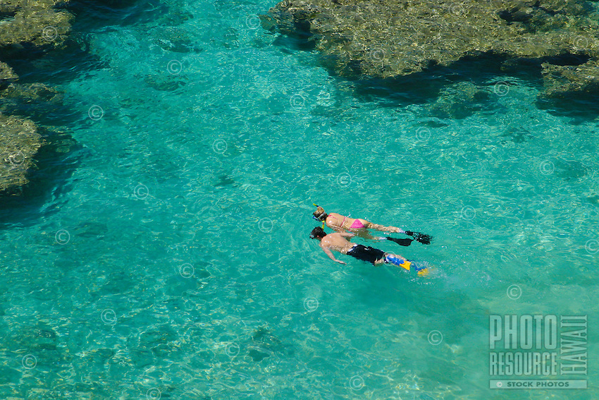Snorkelers interact with colorful reef fishes, sea turtles and much more in Hanauma Bay. A marine life conservation area on the island of Oahu.