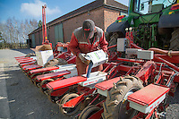Filling sugar beet drill with seed - Norfolk, March
