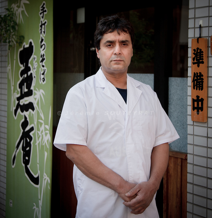 Kawasaki, Januray 12 2011 - Algerian chef Belouazani Lakhdar in front of his Japanese noodles (soba) restaurant near Tokyo. He's been making soba noodles for 17 years in the area and appears to be the only foreigner in the world to cook soba noodles.