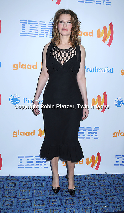 actress Sandra Bernhard in Catherine Malandrino dress posing for photographers at The 21st Annual GLAAD Media Awards on March 13, 2010 at The Marriott Marquis Hotel in New York City. The Honorees wereJoy Behar and Cynthia Nixon.
