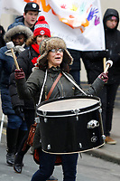 A drummer leads the way in the Red, White & Black day procession in support of Charlton Athletic Race & Equality Partnership (CARE) during the Sky Bet League 1 match between Charlton Athletic and Fleetwood Town at The Valley, London, England on 17 March 2018. Photo by Carlton Myrie.