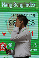 Local passes the Hang Seng Bank with the stock exchange prices for the day, Hong Kong, China. Stocks prices have dropped all across the region in the past months as the economic outlook has worsened....................Locals pass the Hang Seng Bank with the stock exchange prices for the day, 31-Oct-11.  Stocks prices have dropped all across the region in the past months as the economic outlook has worsened..31-Oct-11...................