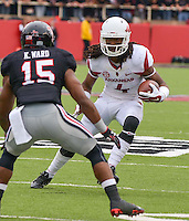 STAFF PHOTO BEN GOFF  @NWABenGoff -- 09/13/14 Arkansas wide receiver Keon Hatcher (4) evades Texas Tech free safety Keenon Ward in the first quarter of the game in Jones AT&T Stadium in Lubbock, Texas on Saturday September 13, 2014.