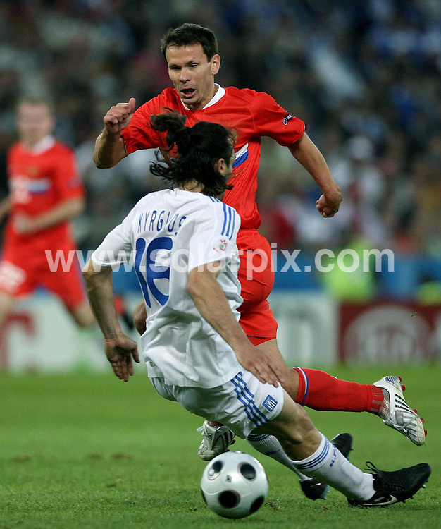**ALL ROUND PICTURES FROM SOLARPIX.COM**.**SYNDICATION RIGHTS FOR UK AND SPAIN ONLY**.Euro 2008, European Championship 2008, Group C, Match 14, Greece vs Russia, Wals-Siezenheim Stadium, Salzburg, Austria. 14 June 2008. The match ended 1-0 for Russia..This pic: Sotirios Kyrgiakos and Konstantin Zyryanov..JOB REF: 6648 CPR/Ronny Hartmann    .DATE: 14_06_2008.**MUST CREDIT SOLARPIX.COM OR DOUBLE FEE WILL BE CHARGED* *UNDER NO CIRCUMSTANCES IS THIS IMAGE TO BE REPRODUCED FOR ANY ONLINE EDITION WITHOUT PRIOR PERMISSION*