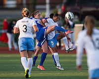 Boston Breakers defender Cat Whitehill (4) and Chicago Red Stars forward Maribel Domingues (9) battle for a high ball.  In a National Women's Soccer League Elite (NWSL) match, the Boston Breakers defeated  Chicago Red Stars 4-1, at the Dilboy Stadium on May 4, 2013.