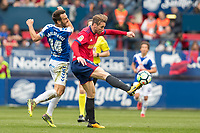 SADAR, PAMPLONA, SPAIN: La Liga de Fútbol, ​​CA Osasuna vs Tenerife; Xisco, player of Osasuna, centers a ball in the presence of the defender of Tenerife Carlos Ruiz during the match of the League 123, on April 1, 2018