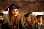 Sarah Pinter listens to the student speaker address  during undergraduate commencement ceremonies. Photo by Ben Siegel