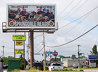NWA Democrat-Gazette/JASON IVESTER<br /> Billboard with Springdale High School football coach Zak Clark and Springdale Har-Ber High School football coach Chris Wood promoting Springdale Public Schools on display on S. Pleasant Street in Springdale; photographed on Tuesday, June 13, 2017, for web story