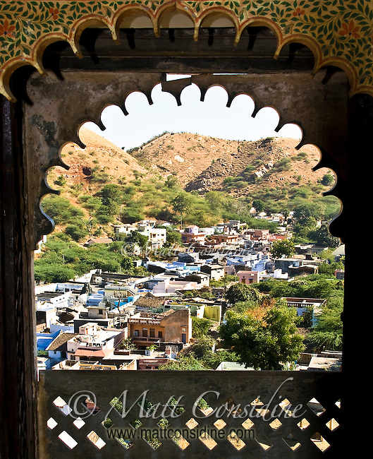 Old palace overlooking town nestled in the Rajasthani hills.<br /> (Photo by Matt Considine - Images of Asia Collection)