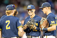 Michigan Wolverines third baseman Blake Nelson (10) smiles in between innings Game 6 of the NCAA College World Series against the Florida State Seminoles on June 17, 2019 at TD Ameritrade Park in Omaha, Nebraska. Michigan defeated Florida State 2-0. (Andrew Woolley/Four Seam Images)