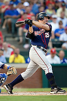 Minnesota Twins designated hitter Jim Thome #25 swings during a Major League Baseball game against the Texas Rangers at the Rangers Ballpark in Arlington, Texas on July 27, 2011. Minnesota defeated Texas 7-2.  (Andrew Woolley/Four Seam Images)