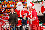 Santa At Seanchai: Visiting Santa & Mrs Claus at his cave in the Seanchai Centre, Listowel on Sunday last were Jamie Barry & Rebecca Sparkes.