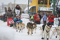 Tom Thurston leaves the 2011 Iditarod ceremonial start line in downtown Anchorage, during the 2012 Iditarod..Jim R. Kohl/Iditarodphotos.com