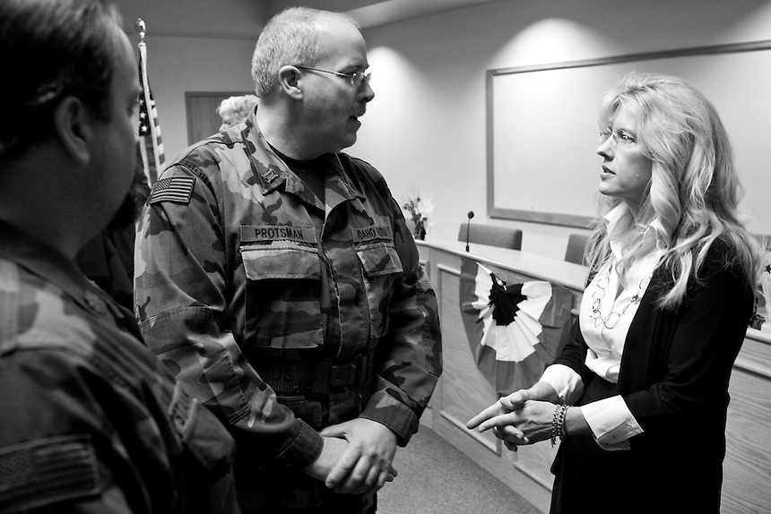 Commander Jeff Stankiewicz and Captain Willard Protsman of the 21st Battalion of Light Foot Militia visit with Kootenai County Commissioner Jai Nelson during her inauguration day on February 20, 2011. ..Nelson is a strong tea party supporter in northern Idaho and requested the militia attend her inauguration in solidarity with the movement, according to them.