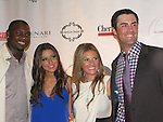 First baseman Ryan Howard and date pose with Philadelphia Phillies Pitcher Cole Hamels and wife Heidi who head the Hamels Foundation as it presents Diamonds & Denim on August 27, 2012 at the Crystal Tea Room, Philadelphia, Pennsylvania.  (Photo by Sue Coflin/Max Photos)