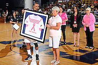 25 February 2012:  FIU's DeJuan Wright (14) presents a jersey to Nadine Thordarson during a ceremony honoring cancer survivors prior to the game.  The FIU Golden Panthers defeated the University of South Alabama Jaguars, 81-74, at the U.S. Century Bank Arena in Miami, Florida.