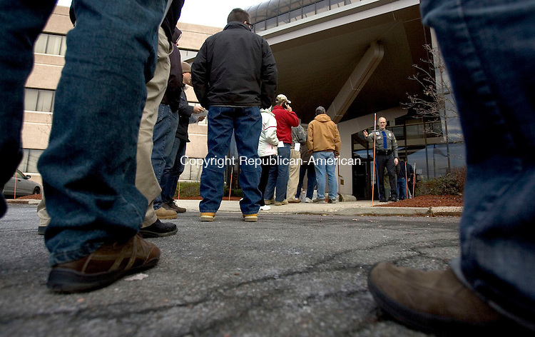 MIDDLETOWN CT. 30 December 2013-123013SV01-Owners of assault weapons and high capacity magazines wait in line to register them at the Department of Emergency Services and Public Protection Special Licensing and Firearms in Middletown Monday. <br /> Steven Valenti Republican-American