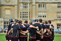 Bath players huddle together outside Farleigh House. Bath Rugby training session on August 21, 2012 at Farleigh House in Bath, England. Photo by: Patrick Khachfe/Onside Images