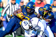 Morgantown, WV - NOV 10, 2018: West Virginia Mountaineers wide receiver Gary Jennings Jr. (12) runs over TCU Horned Frogs linebacker Arico Evans (7) for a 3rd quarter touchdown during game between West Virginia and TCU at Mountaineer Field at Milan Puskar Stadium Morgantown, West Virginia. (Photo by Phil Peters/Media Images International)