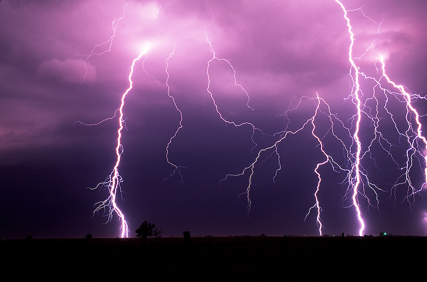 A barrage of lightning forks to the ground near Union City Oklahoma during a severe springtime thunderstorm.