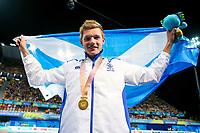 Picture by Alex Whitehead/SWpix.com - 08/04/2018 - Commonwealth Games - Swimming - Optus Aquatics Centre, Gold Coast, Australia - Duncan Scott of Scotland wins Gold in the Men's 100m Freestyle final.