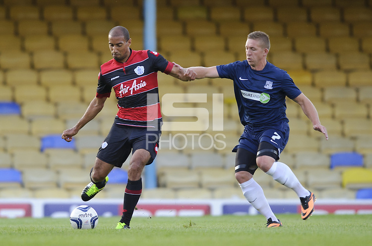 Karl Henry of QPR and Freddy Eastwood of Southend United