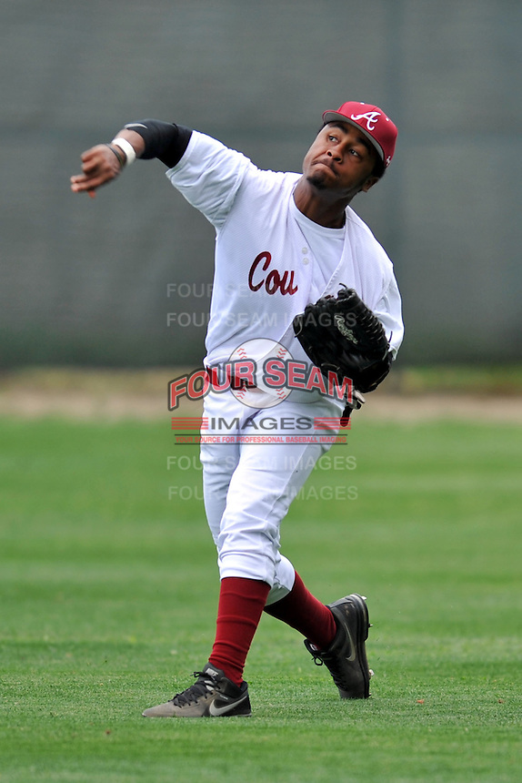 Asheville Cougars right fielder Timon Salters #6 fields and throws from right during a game against the T.C. Roberson Rams  at Asheville High on April 15, 2013 in Asheville, North Carolina. The Rams won 4-1. (Tony Farlow/Four Seam Images).