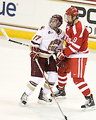 Brian Gibbons (BC - 17) ties up Alex Chiasson (BU - 9) by keeping his arm clamped on Chiasson's stick. - The Boston College Eagles defeated the visiting Boston University Terriers 5-2 on Saturday, December 4, 2010, at Conte Forum in Chestnut Hill, Massachusetts.