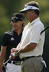 6 September 2008:    Camilo Villegas (left) and Kenny Perry wait to putt on the second hole in the second round of play at the BMW Golf Championship at Bellerive Country Club in Town & Country, Missouri, a suburb of St. Louis, Missouri.  The BMW Championship is the third event on the PGA's Fed Ex Tour. Villegas, of Medellin Colombia (South America) was the leader after the conclusion of round one with a five-under par score.