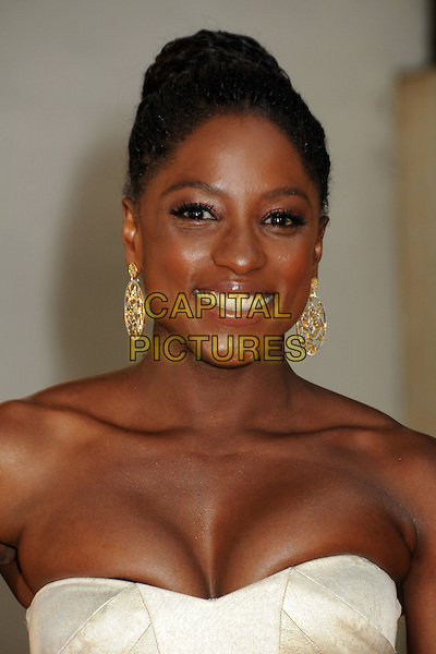 "RUTINA WESLEY.HBO's ""True Blood"" Season 3 Premiere held at Arclight Cinemas Cinerama Dome, Hollywood, California, USA..June 8th, 2010.headshot portrait strapless gold beige dangling earrings cleavage smiling .CAP/ADM/BP.©Byron Purvis/AdMedia/Capital Pictures."