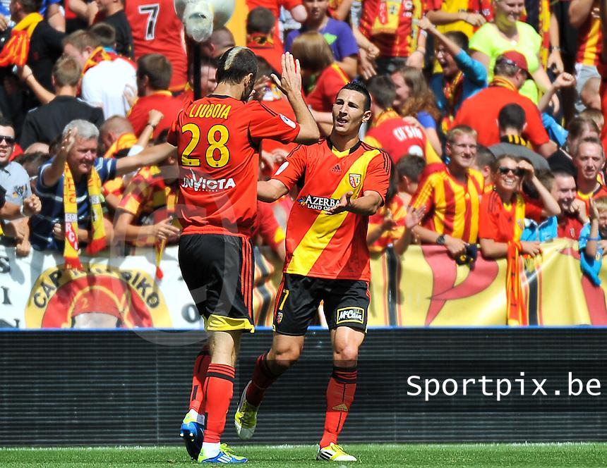 RC Lens - AJ Auxerre : Yoann Touzghar (right) celebrating his goal<br /> foto David Catry / nikonpro.be